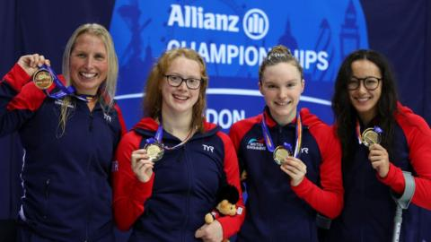 Great Britain (Stephanie Millward, Brock Whiston, Toni Shaw and Alice Tai) pose with their gold medals after winning the women's 4x100m freestyle relay
