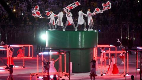 Japanese performers take part in the closing ceremony