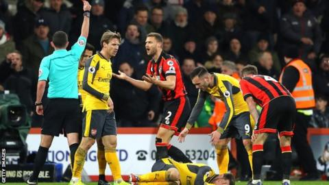 Simon Francis is shown the red card