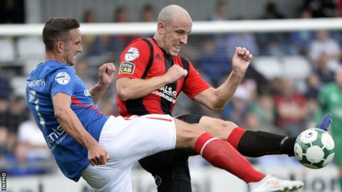 Andy Waterworth and Mark McChrystal in action during Linfield's 2-0 win over Crusaders at Seaview in August