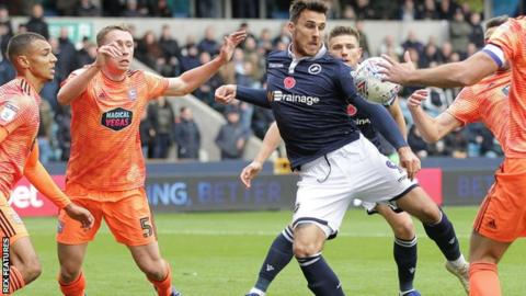 Lee Gregory volleys in his first goal for Millwall against Ipswich