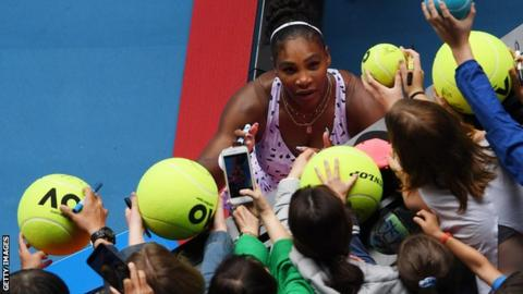 Serena Williams signs giant tennis balls for fans at the Australian Open in January