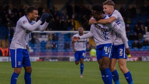 Bury celebrate what proved to be the matchwinner against Burton Albion at Gigg Lane