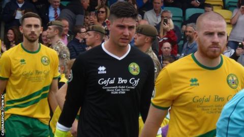 Nathan Craig leads out Caernarfon Town
