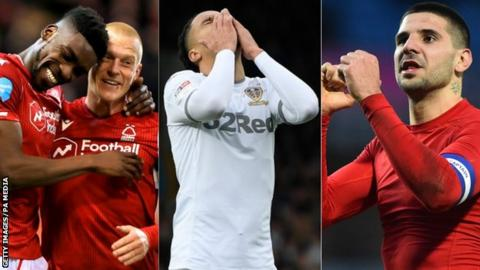Nottingham Forest players celebrate, Helder Costa of Leeds and Aleksandar Mitrovic of Fulham