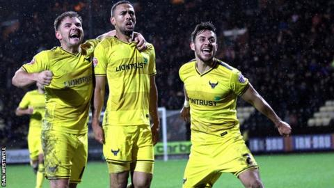 Oxford's players celebrate Kemar Roofe goal, which sealed a 4-2 win over Notts County