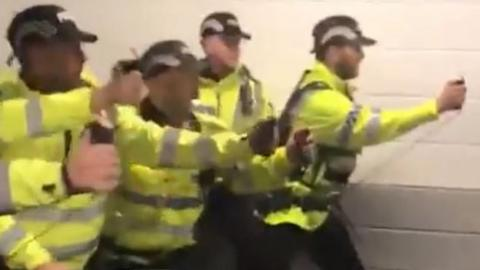 A screengrab of footage appearing to show police using a spray on fans at Deepdale on Saturday