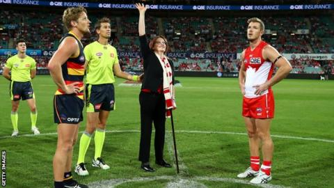 Cynthia Banham tosses the coin on the Sydney Swans pitch