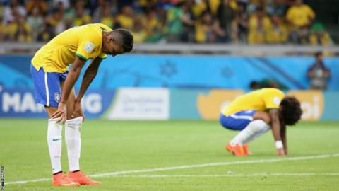 Luiz Gustavo and Marcelo Vieira of Brazil look dejected after the 2014 FIFA World Cup Brazil Semi Final match between Brazil and Germany