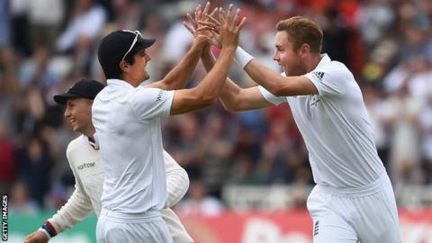 Stuart Broad celebrates a wicket with Alastair Cook