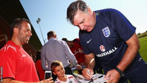 Sam Allardyce signs autographs
