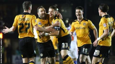 Newport County players celebrate Mark Byrne's goal against Blackburn Rovers