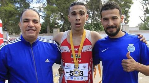 Abu Al-Qasem Rajab (centre) with his bronze medal flanked by his brother Mohammed Rajab (right) and the president of the General Authority for Youth and Sports Bashir Kantari