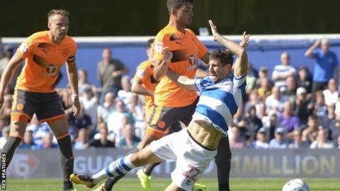 Tiago Ilori fouls Pawel Wszolek and is sent off for Reading v QPR