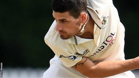Benny Howell bowls for Gloucestershire