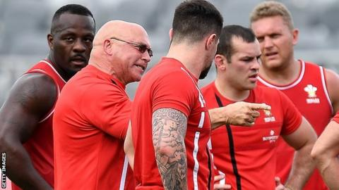 John kear, surrounded by Wales players, makes a point to his squad during a training session
