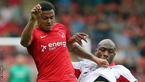 Leyton Orient's Josh Koroma and Wrexham's Manny Smith battle for the ball