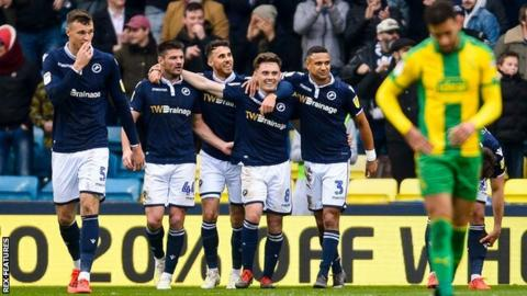 Millwall players celebrate after an own goal by Ahmed Hegazi