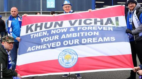 Leicester fans with a flag dedicated to Vichai