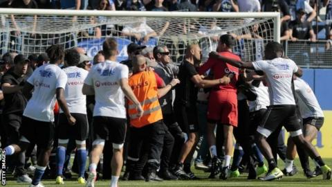 Bastia fans invade the pitch against Lyon
