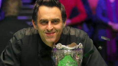 Ronnie O'Sullivan poses with the UK Championship trophy after beating Shaun Murphy in the final