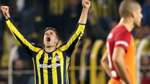 Robin van Persie celebrates scoring for Fenerbahce against Galatasaray.