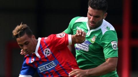 Wrexham's Hamza Bencherif (right) in action against Dagenham & Redbridge