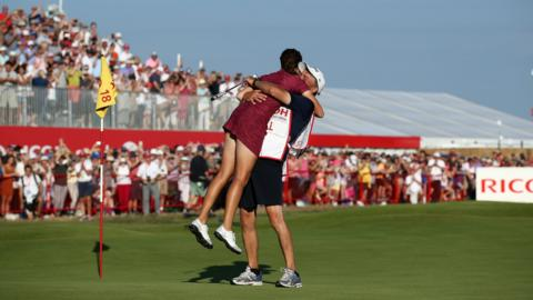 LYTHAM ST ANNES, ENGLAND - AUGUST 05: Georgia Hall of England celebrates with her father / caddie Wayne Hall on the 18th green during the final round the Ricoh Women's British Open at Royal Lytham & St. Annes on August 5, 2018 in Lytham St Annes, England. (Photo by Jan Kruger/WME IMG/WME IMG via Getty Images)