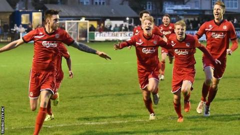 Ryan Brett celebrates after scoring Truro's equaliser with 33 seconds left