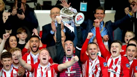Derry City captain Gerard Doherty holds the EA Sports Cup aloft after his team's victory at the Brandywell