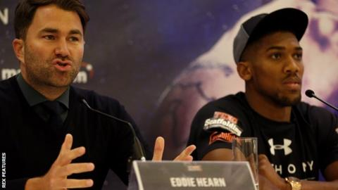 Anthony Joshua (right) with his promoter Eddie Hearn