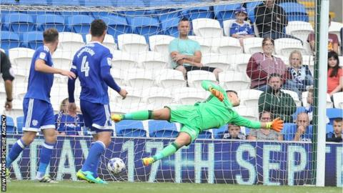 Cardiff City goalkeeper Ben Wilson is beaten by a shot from Yann Kermorgant