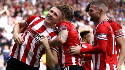 Sheffield United's players celebrate scoring against Crystal Palace
