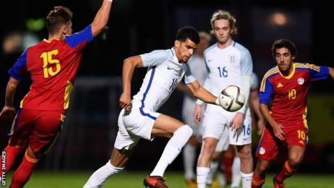 Dominic Solanke and Tom Davies in action for England Under-21s against Andorra Under-21s