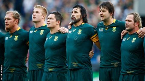 The South Africa team stand for their national anthem at the Rugby World Cup
