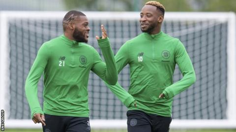 Moussa Dembele chats with Olivier Ntcham at Celtic training