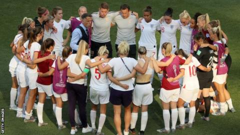 Phil Neville speaks to his players after their defeat by Sweden in the third-place play-off