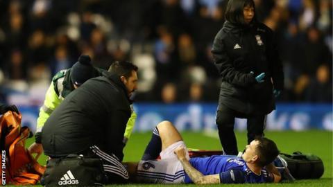Josh McEachran receiving medical treatment