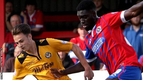 Aaron Collins (left) leads a Newport County attack against Dagenham & Redbridge