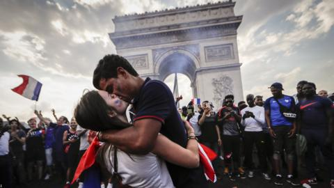 French fans celebrate winning the World Cup on the Champs-Elysees