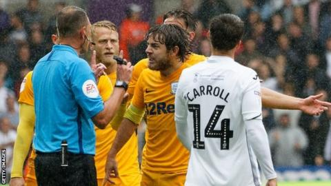 Declan Rudd protest to referee James Linington over a penalty award to Swansea