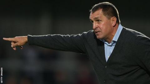 Barnet boss Martin Allen looks on from the sidelines