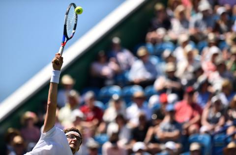 Uzbekistan's Denis Istomin serves against Italy's Andreas Seppi during a men's singles first round match at the ATP Nature Valley International tennis tournament in Eastbourne, southern England on June 25, 2018. (Photo by Glyn Kirk/AFP)