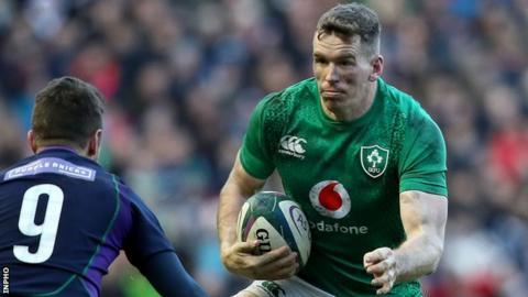 Ireland's Chris Farrell takes on Scotland's Greig Laidlaw