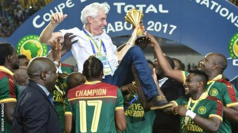 Cameroon boss Hugo Broos is lifted aloft by his players