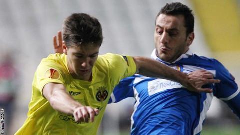 Villarreal's Luciano Vietto and Apollon's Georgios Vasiliou fight for the ball