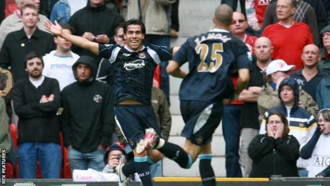 Carlos Tevez celebrates scoring for West Ham at Old Trafford