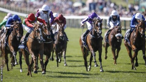 Billesdon Brook and Sean Levey (red and green colours) race to 1,000 Guineas victory