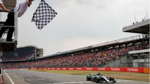 Lewis Hamilton crosses the line to win the 2018 German Grand Prix