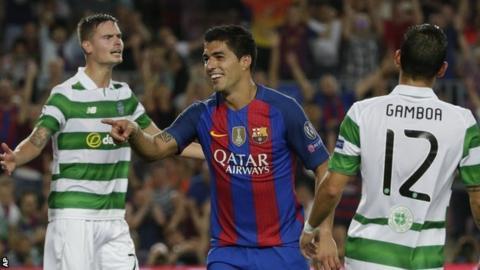 Barcelona's Luis Suarez celebrates scoring against Celtic